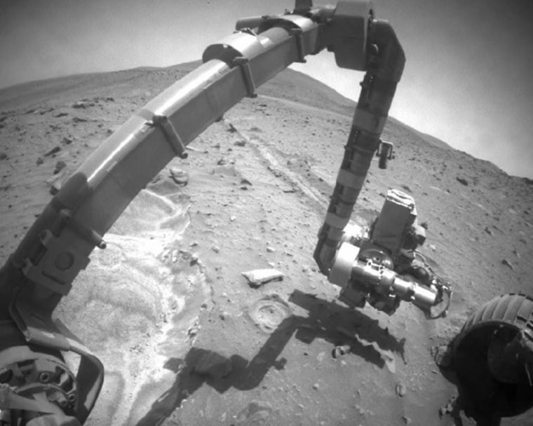 """Spirit's right-front wheel, visible in this October 2009 image, has not worked since 2006. It is the least-stuck of the rover's six wheels at the current location, called """"Troy."""""""
